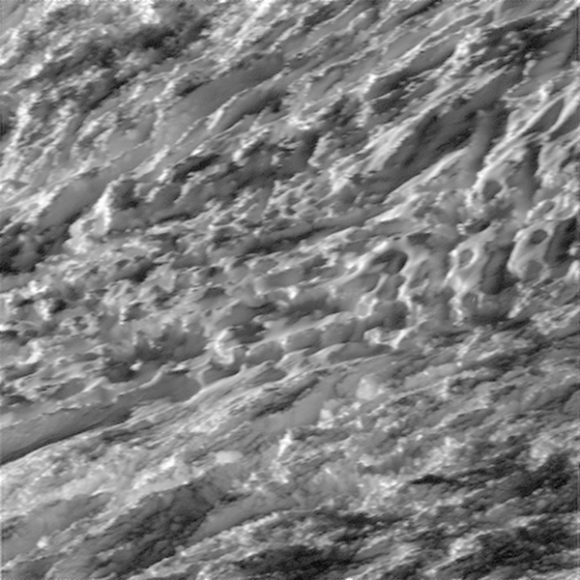 This view is centered on terrain at 57 degrees south latitude, 324 degrees west longitude. The image was taken in visible light with the Cassini spacecraft wide-angle camera on Oct. 28, 2015. The view was acquired at a distance of approximately 77 miles (124 kilometers) from Enceladus. Image scale is 49 feet (15 meters) per pixel.