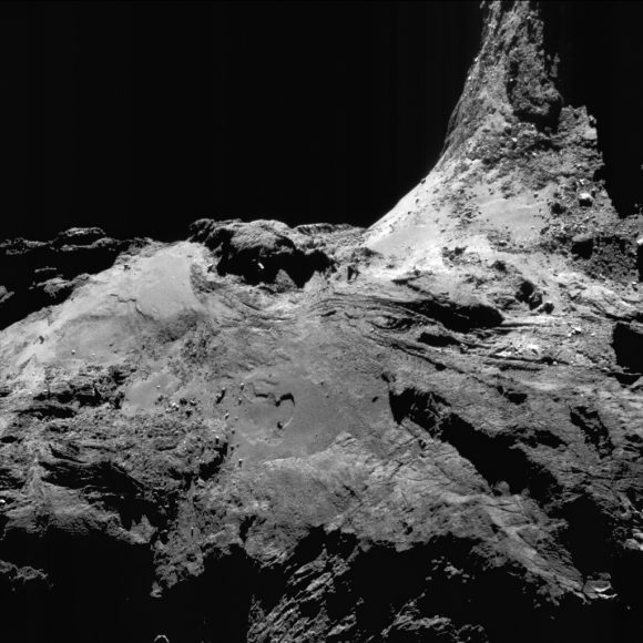 Enhanced NAVCAM image of Comet 67P/C-G taken on 25 June 2016, 16.7 km from the nucleus. The scale is 1.4 m/pixel and the image measures 1.5 km across. Credits: ESA/Rosetta/NAVCAM – CC BY-SA IGO 3.0