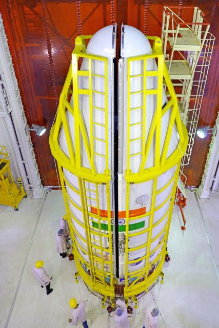pslv-c37heat-shieldisbeingclosedwithallthe104satellitesinside