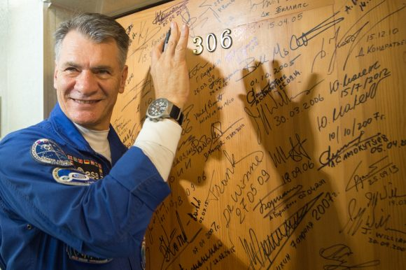 Paolo_Nespoli_performs_the_traditional_door_signing_at_the_Cosmonaut_Hotel