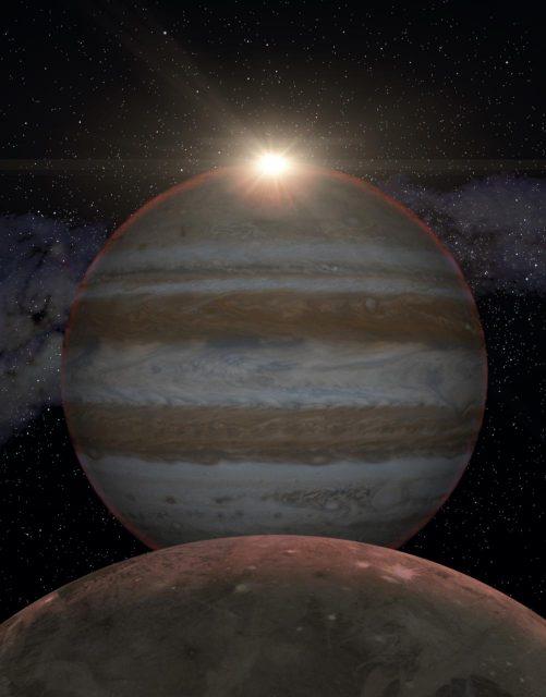 Durante el eclipse de Sol visto desde Ganímedes la luz solar atraviesa la atmósfera de Júpiter (IAC).