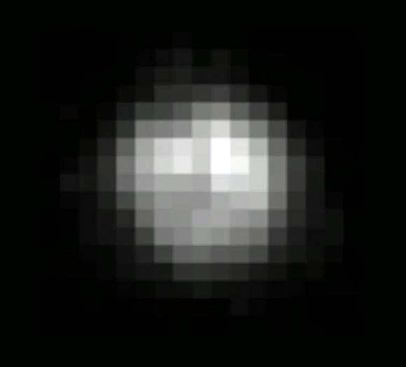 La mejor imagen no tratada de Pultón por parte del telescopio espacial Hubble (NASA).
