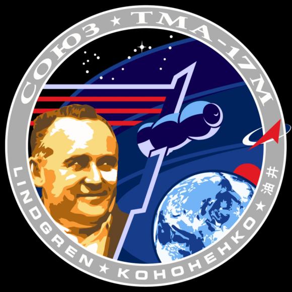 Emblema de la misión, inspirado en el del Apolo 17, con la efigie de Serguéi Koroliov (Roscosmos).