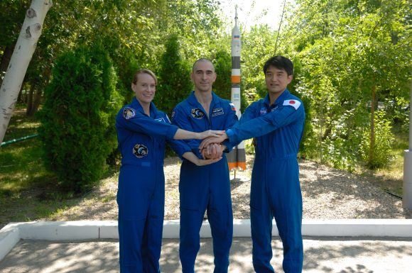 At the Cosmonaut Hotel in Baikonur, Kazakhstan, Expedition 48-49 crewmembers Kate Rubins of NASA (left), Anatoly Ivanishin of Roscosmos (center) and Takuya Onishi of the Japan Aerospace Exploration Agency (right) pose for pictures June 30 during traditional pre-launch activities. Rubins, Ivanishin and Onishi will launch July 7, Baikonur time, on the Soyuz MS-01 spacecraft for a planned four-month mission on the International Space Station. NASA/Alexander Vysotsky