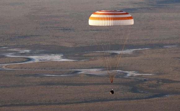 A landing module of the Russian Soyuz TMA-19M space craft carrying  crew of the International Space Station Russian cosmonauts Alexei Ovchinin, Oleg Skripochka and US NASA astronaut Jeffrey Williams lands some 150 km. to the East of the city of Dzhezkazgan in Kazakhstan, 07 September 2016.
