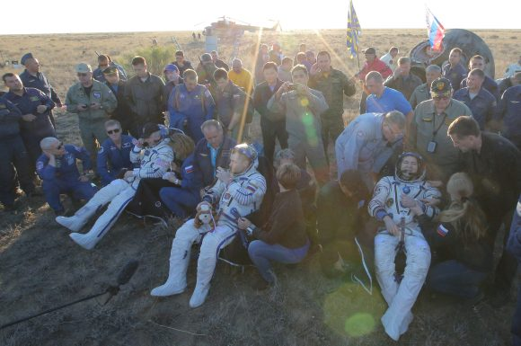 Space crew of the International Space Station: (L-R) US NASA astronaut Jeffrey Williams,  Russian cosmonauts Alexei Ovchinin and Oleg Skripochka rest after landing some 150 km. to the East of the city of Dzhezkazgan in Kazakhstan, 07 September 2016.