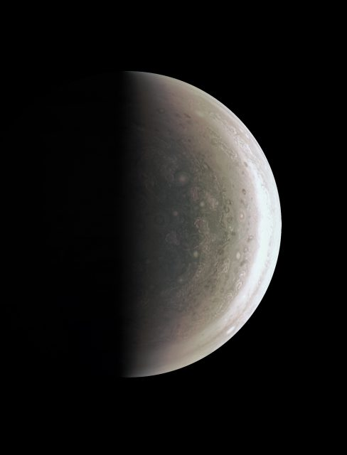 This image from NASA's Juno spacecraft provides a never-before-seen perspective on Jupiter's south pole. The JunoCam instrument acquired the view on August 27, 2016, when the spacecraft was about 58,700 miles (94,500 kilometers) above the polar region. At this point, the spacecraft was about an hour past its closest approach, and fine detail in the south polar region is clearly resolved. Unlike the equatorial region's familiar structure of belts and zones, the poles are mottled by clockwise and counterclockwise rotating storms of various sizes, similar to giant versions of terrestrial hurricanes. The south pole has never been seen from this viewpoint, although the Cassini spacecraft was able to observe most of the polar region at highly oblique angles as it flew past Jupiter on its way to Saturn in 2000 (NASA/JPL-Caltech/SwRI/MSSS).